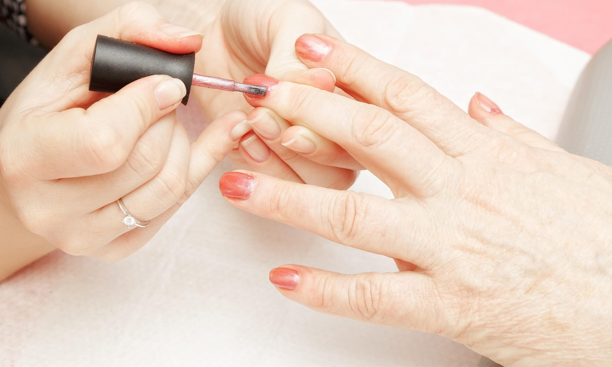 Retiree getting manicure